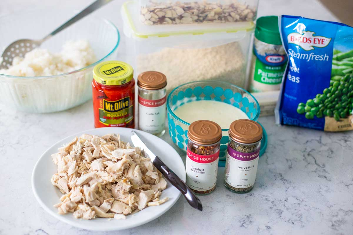 The Ingredients for Chicken Alfredo Rice are on the kitchen counter.