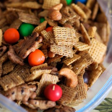 A bag of sweet Chex Mix has nuts, cereal, and red and orange M&M candies.