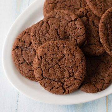 A platter of chocolate crinkle cookies show the Mexican Hot Chocolate Cookie recipe finished.