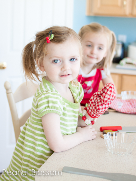 Two little girls ready for holiday baking fun in the kitchen.