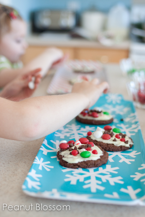 Interactive chocolate peppermint bark cookies are so fun to bake with kids. Let them customize each one with their favorite candy toppings.