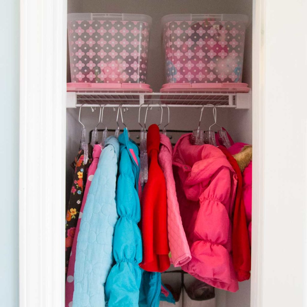 A kids' closet full of coats and organizers.