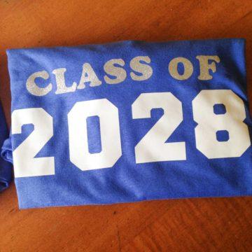 "A class t-shirt says ""Class of 2028"""
