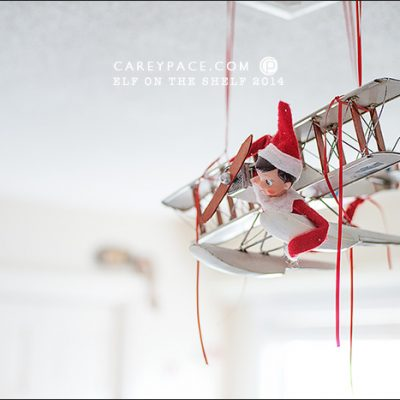 Elf on the Shelf flies airplane by Carey Pace 2014 by Carey Pace