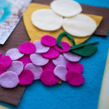 Felt grapes, communion hosts, and challice decorate a homemade First Communion banner.