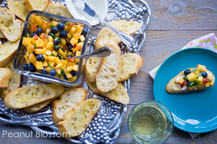 Elegant peach blueberry salsa with goat cheese crostini