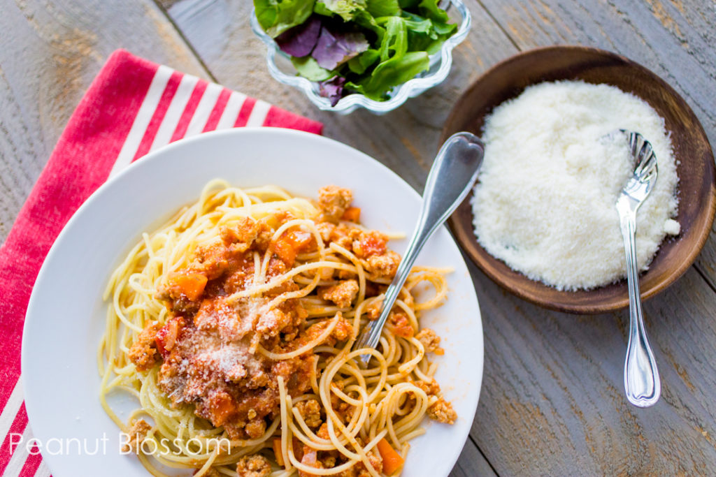 Easy bolognese sauce lightened with chicken and Barilla marinara