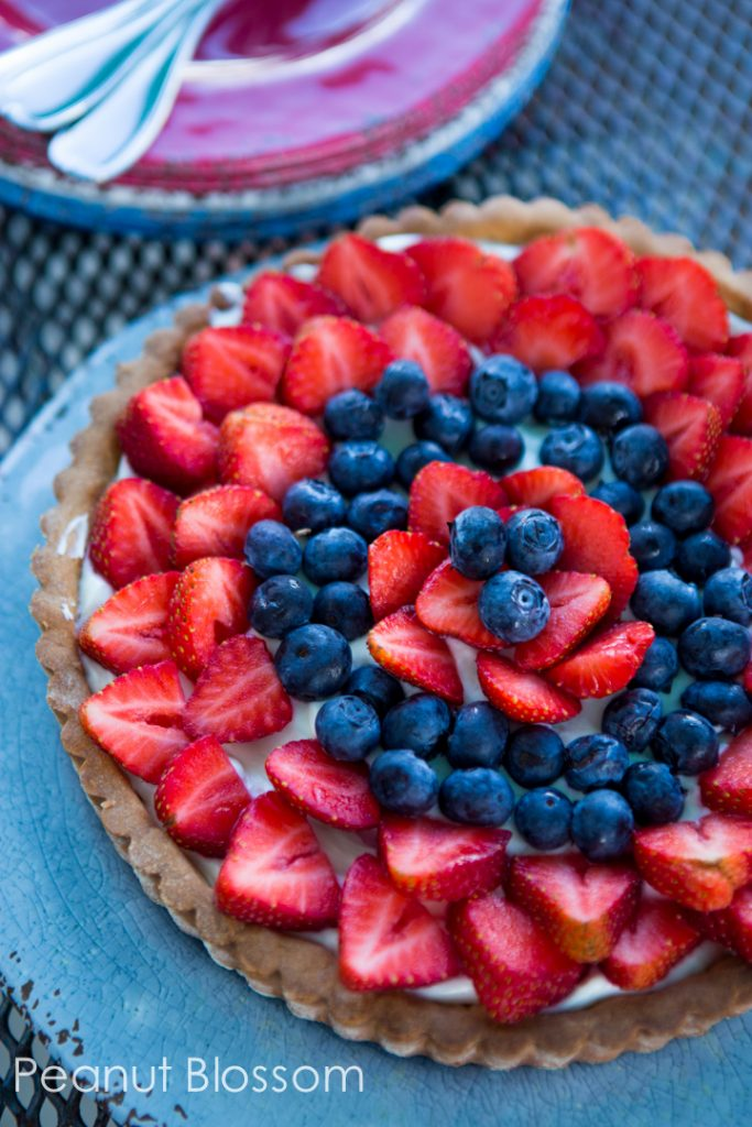 Patriotic red, white, and blue strawberry cream cheese tart