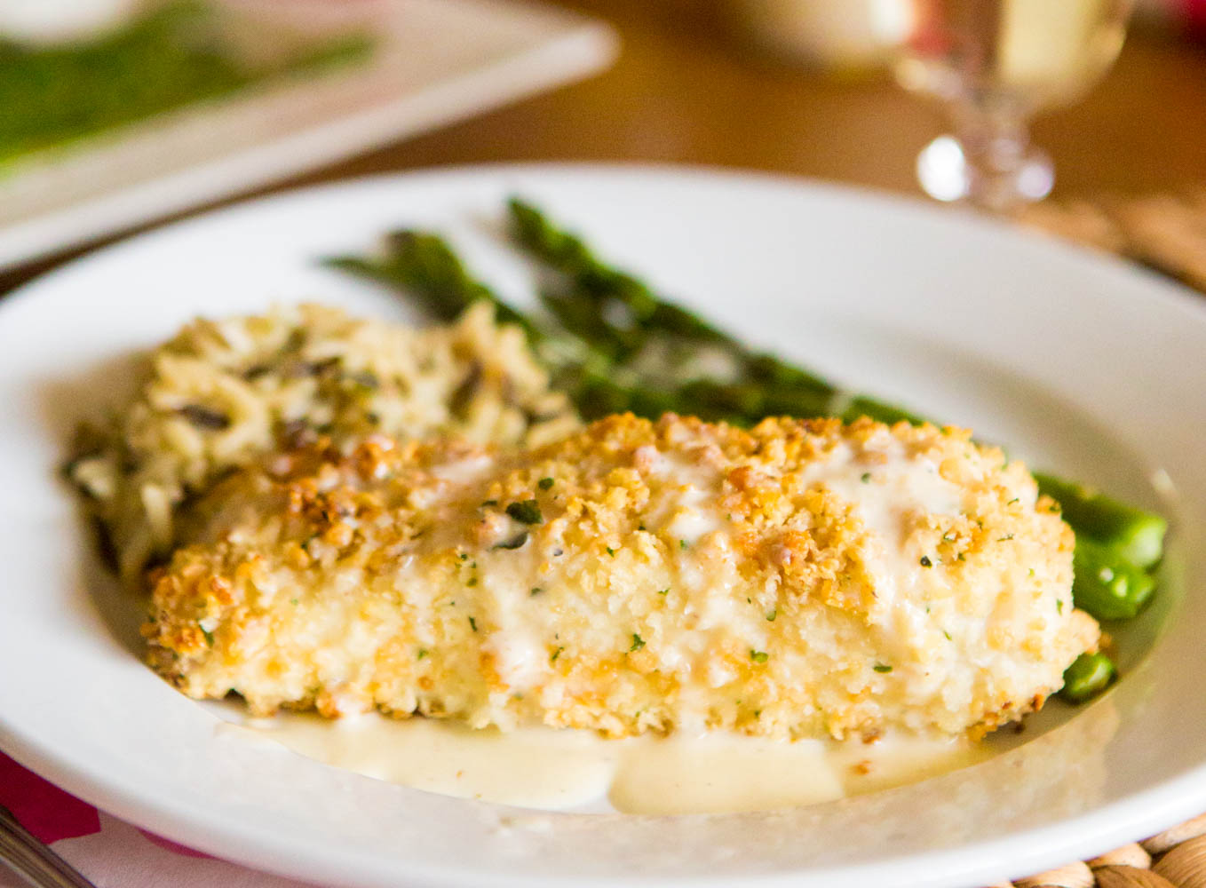 Easy make-ahead macadamia crusted halibut with quick lemon butter cream sauce