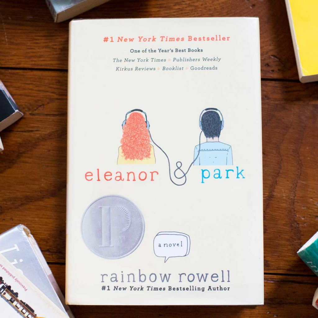 A copy of Eleanor and Park by Rainbow Rowell sits on a table.