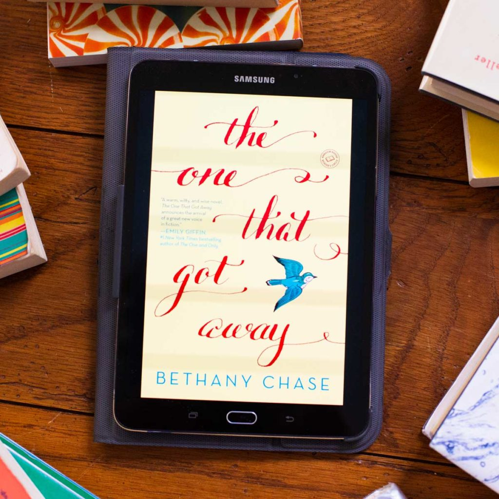 A copy of The One That Got Away appears on a digital reader tablet screen on a table.