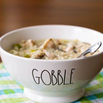 """A bowl of creamy soup says """"Gobble"""" on the front."""