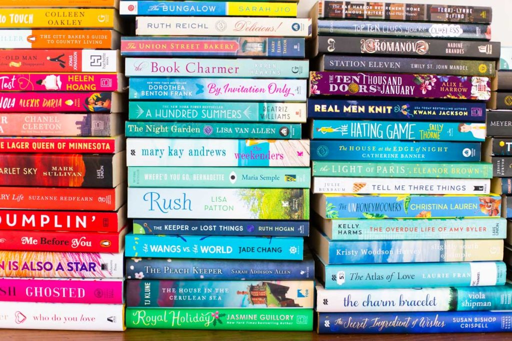 Colorful stacks of fiction books in a row.