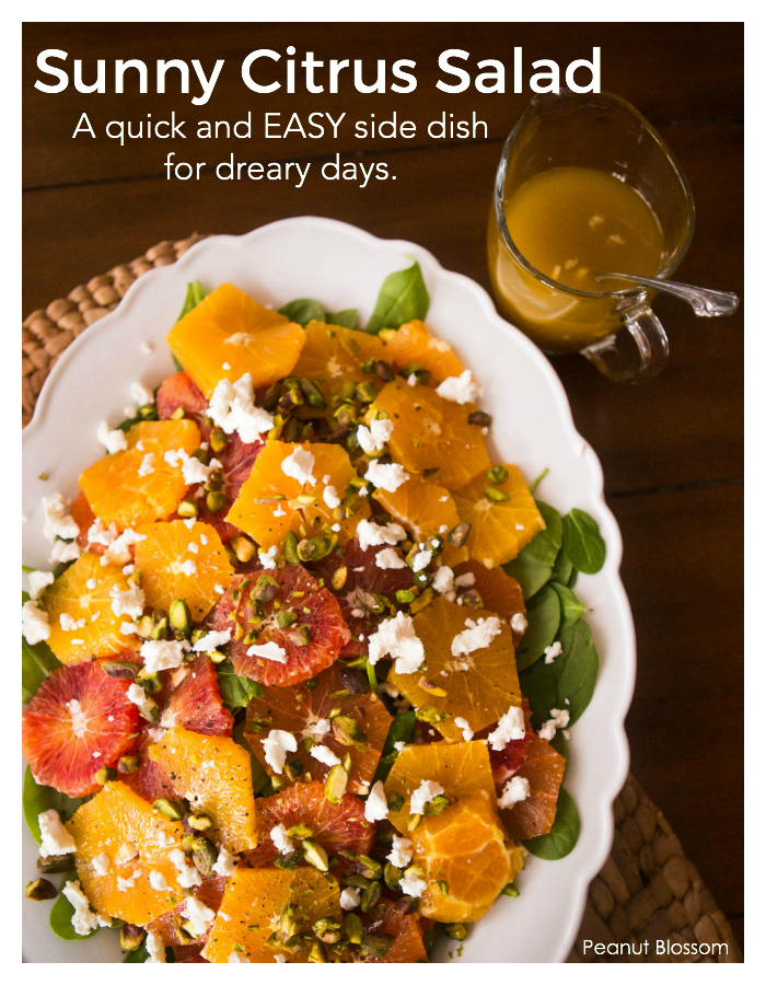 Sunny citrus salad with fresh oranges, spinach, goat cheese, and pistachios.