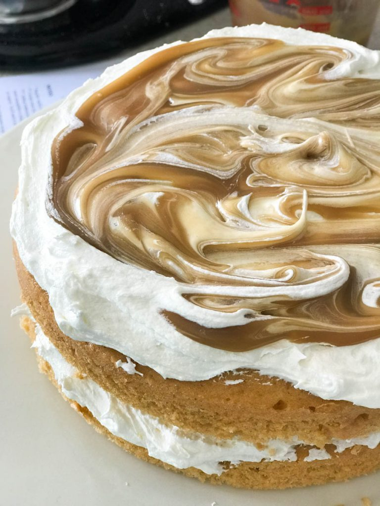 Swirl the butterscotch sauce into the marshmallow topping for an easy Harry Potter cake.