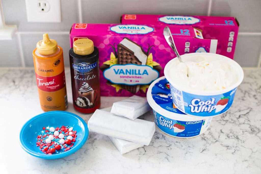The ingredients for the ice cream sandwich cake sit on a kitchen counter.