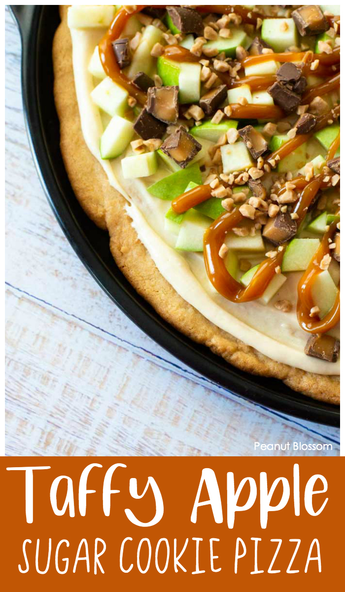 This chewy caramel apple pizza has a sugar cookie crust, cream cheese frosting, and the most delicious chocolate-caramel candy toppings. Perfect for baking with kids.