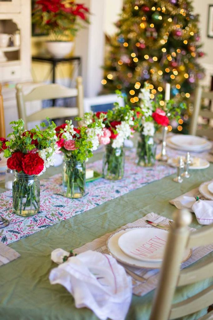 A beautiful Christmas dinner doesn't have to be complicated. This table with fresh flowers in mason jars can be set in minutes.