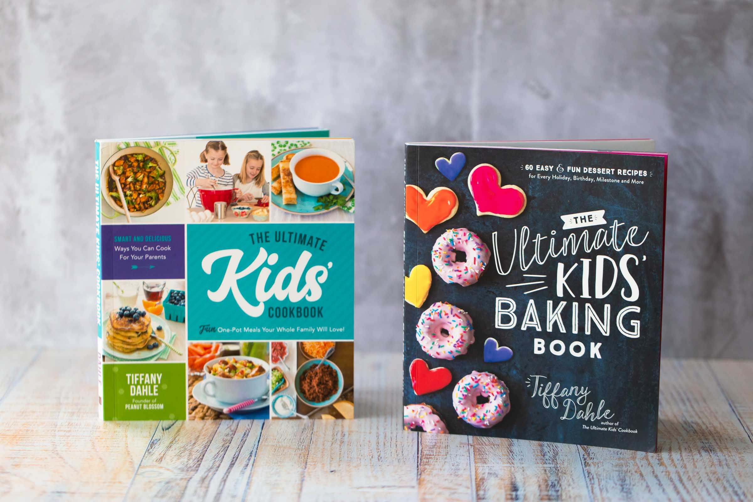 The covers of both The Ultimate Kids' Cookbook by Tiffany Dahle and The Ultimate Kids' Baking Book by Tiffany Dahle