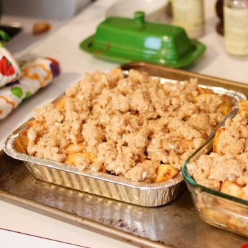 A freezer-friendly metal pan holds an 8x8-inch apple crisp with crumble topping.