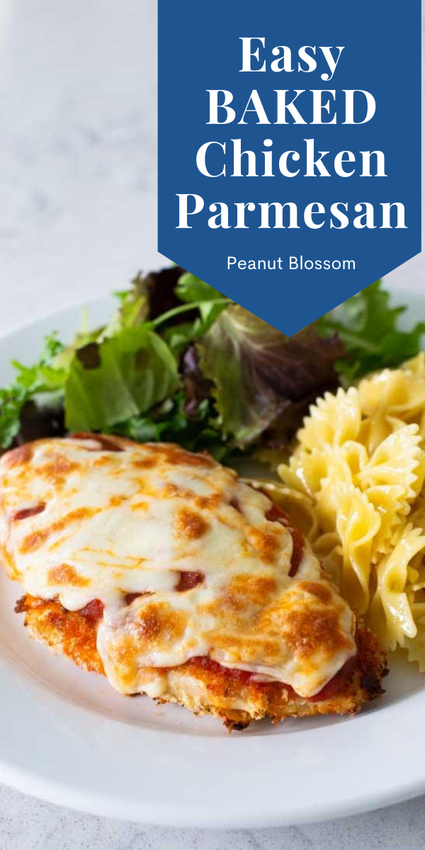 Easy Baked Chicken Parmesan by Peanut Blossom: The finished chicken with melted cheese on a plate with lettuce and pasta.