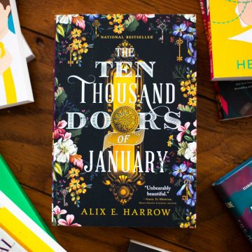 A copy of The Ten Thousand Doors of January by Alix E. Harrow sits on a table.