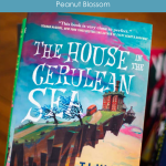 A copy of The house in the Cerulean Sea by TJ Klune with the caption: Book Club Discussion Guide.