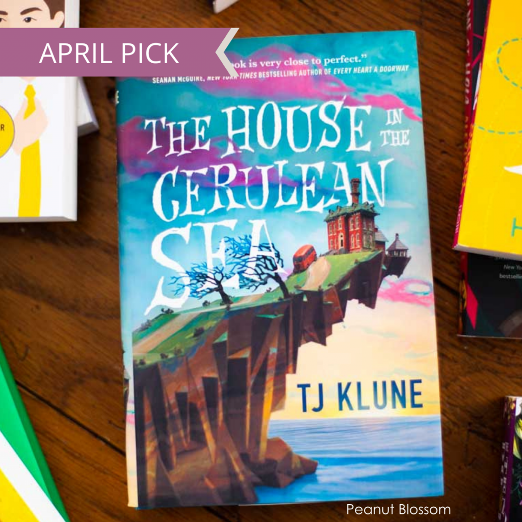 A copy of The House in the Cerulean Sea by TJ Klune with the caption April pick.