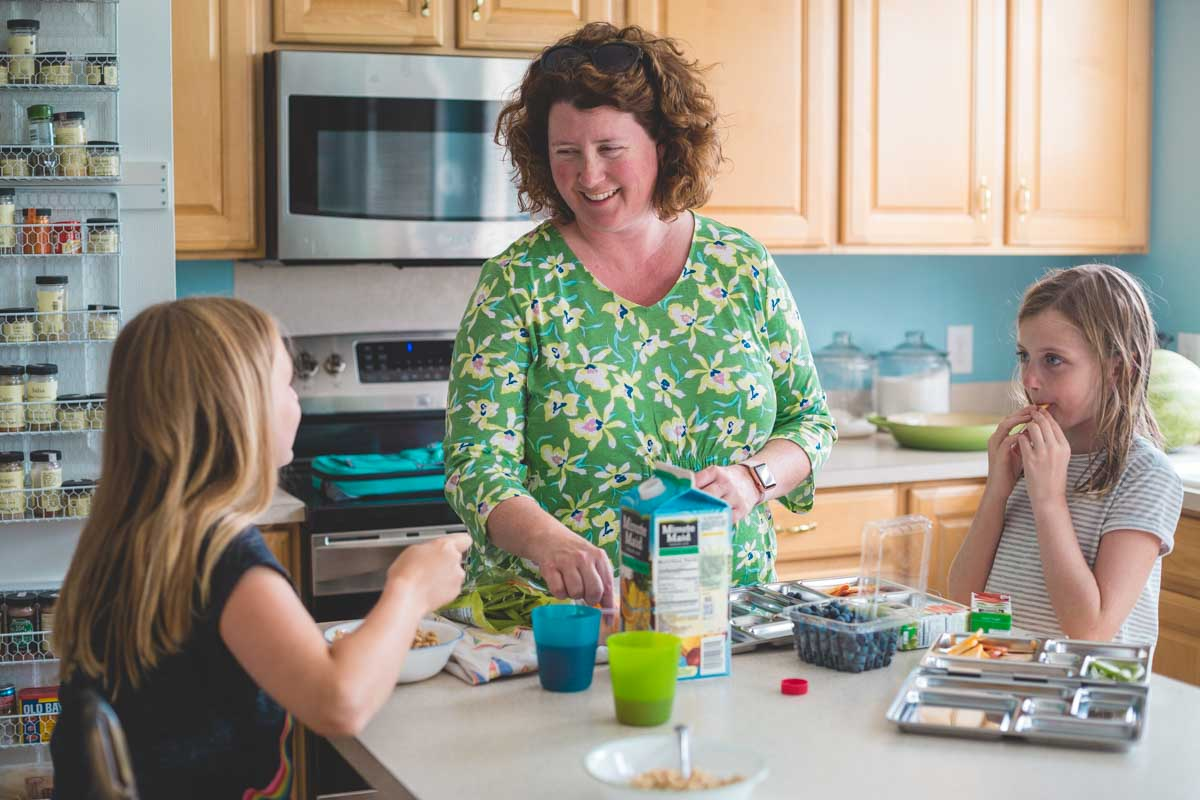 Tiffany Dahle in the kitchen with her two daughters making breakfast.