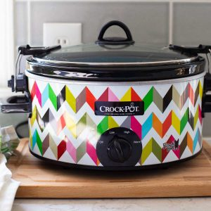 A colorful Crock Pot sits on a kitchen counter to demonstrate a slowcooker recipe category.