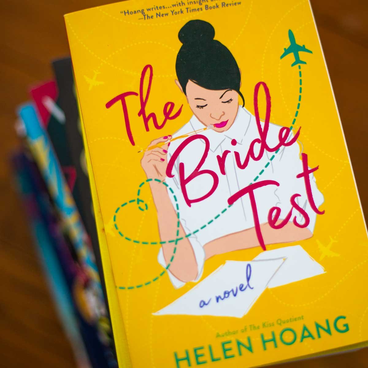 The copy of The Bride Test by Helen Hoang sits on a pile of books.