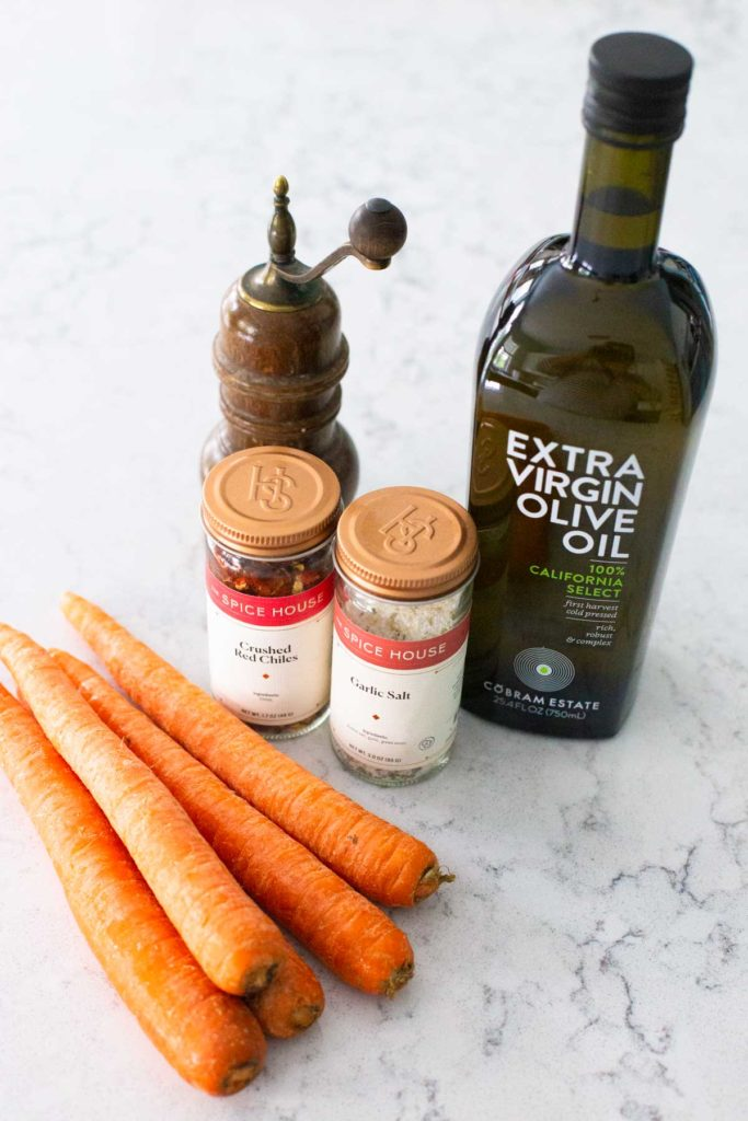 The ingredients for roasted carrots on the counter.