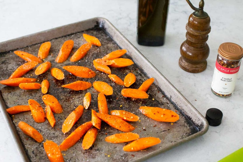 The roasting pan shows how to arrange the carrots in a single layer.