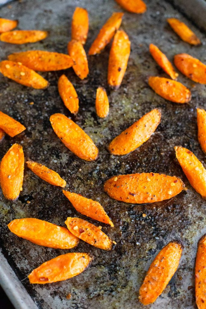 A close-up of the final roasting pan full of roasted carrots.