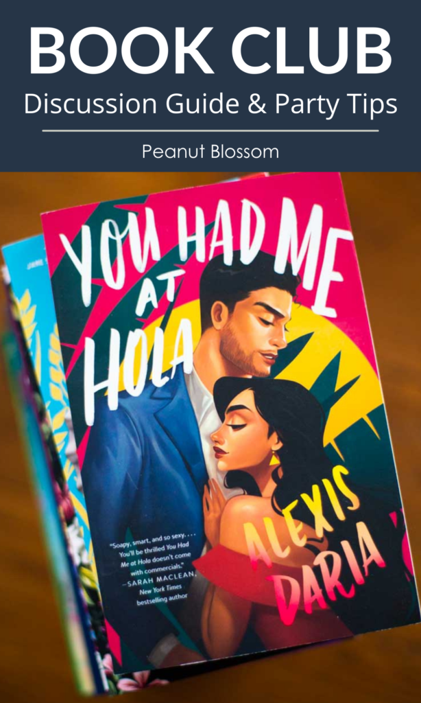 The book You Had Me At Hola by Alexis Daria sits on a table.