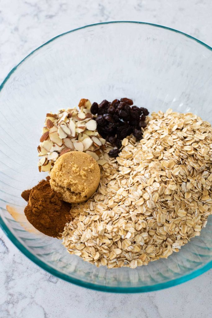 The ingredients for granola are in a large mixing bowl ready to be stirred.