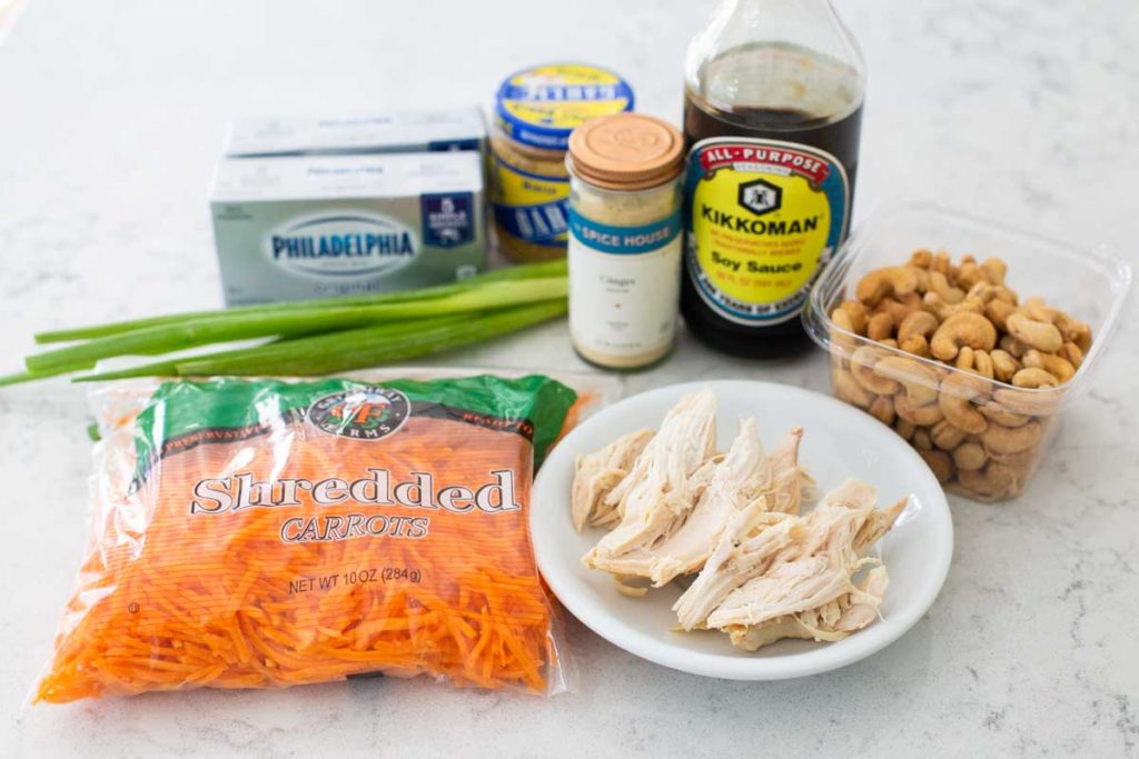 Ingredients for the Asian chicken layered dip are on a counter.