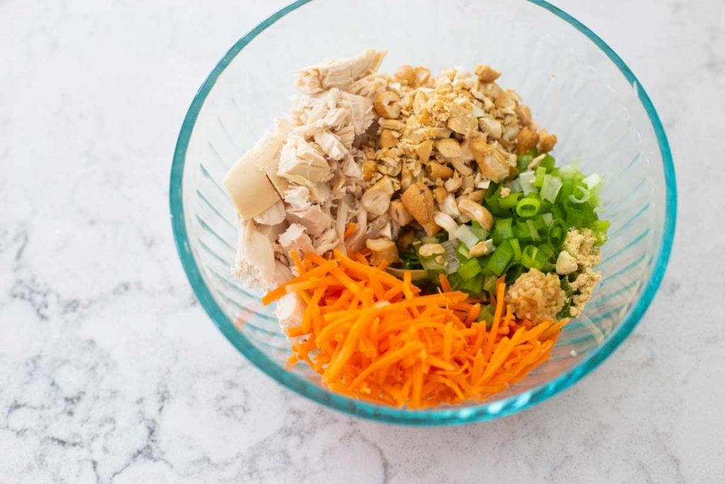 The ingredients for the chicken topping are in a mixing bowl.