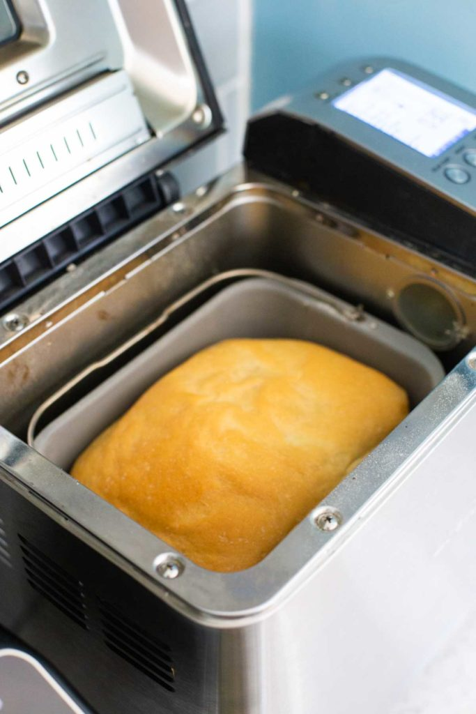 A baked loaf of bread inside the Breville bread machine.