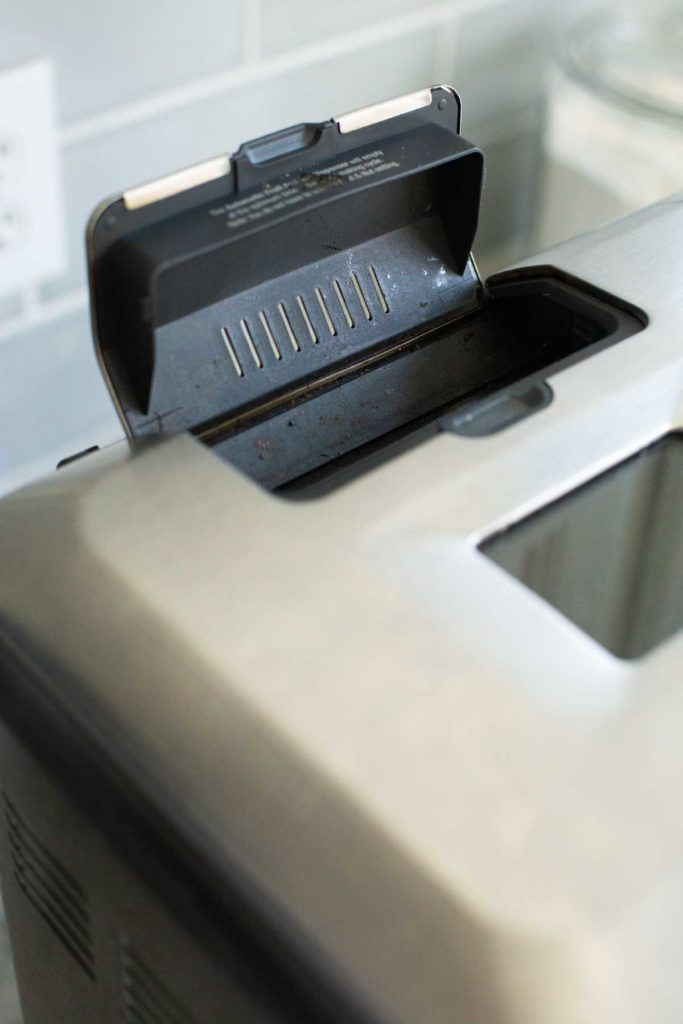 The Breville nut dispenser is shown open.