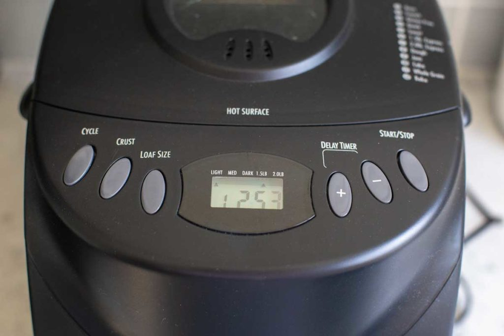A close-up of the program buttons on the Hamilton Beach bread machine.