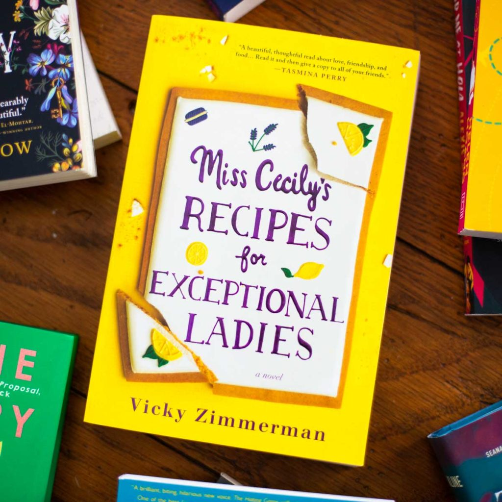A copy of Miss Cecily's Recipes for Exceptional Ladies sits on a table.