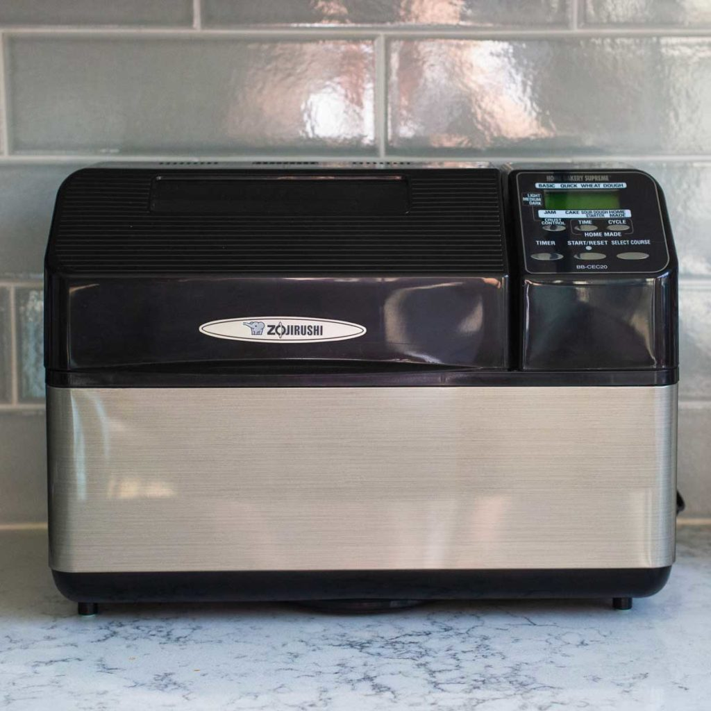 A Zojirushi Bread Maker sits on a kitchen counter.