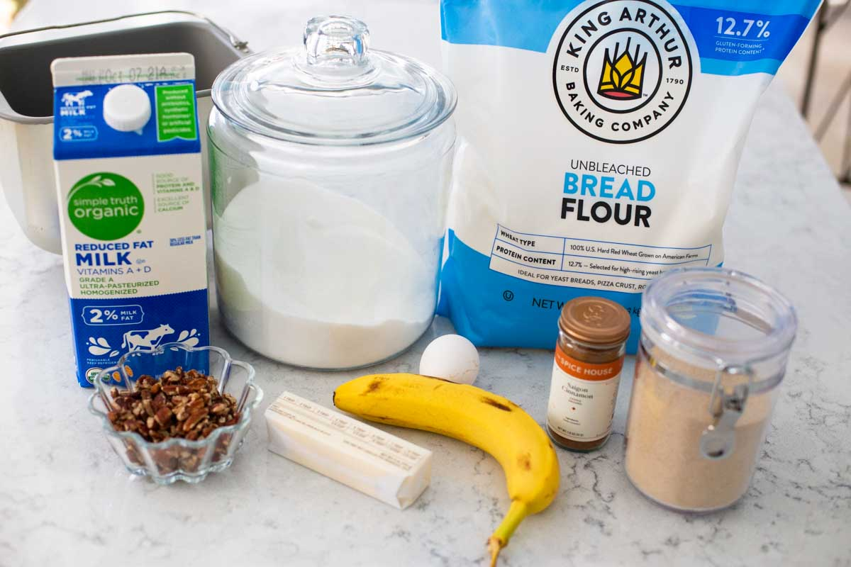 The ingredients for the banana bread are on the counter.