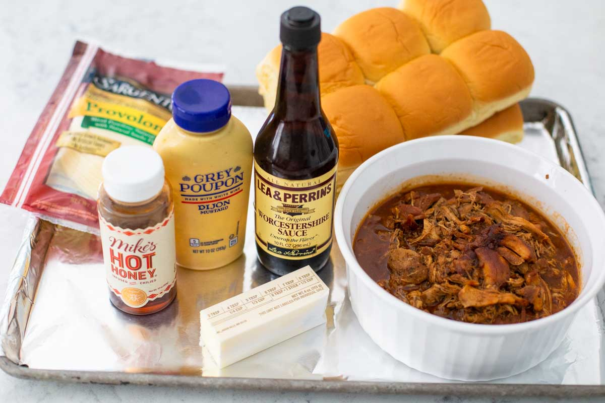 Ingredients for the BBQ chicken sliders are on a tray.