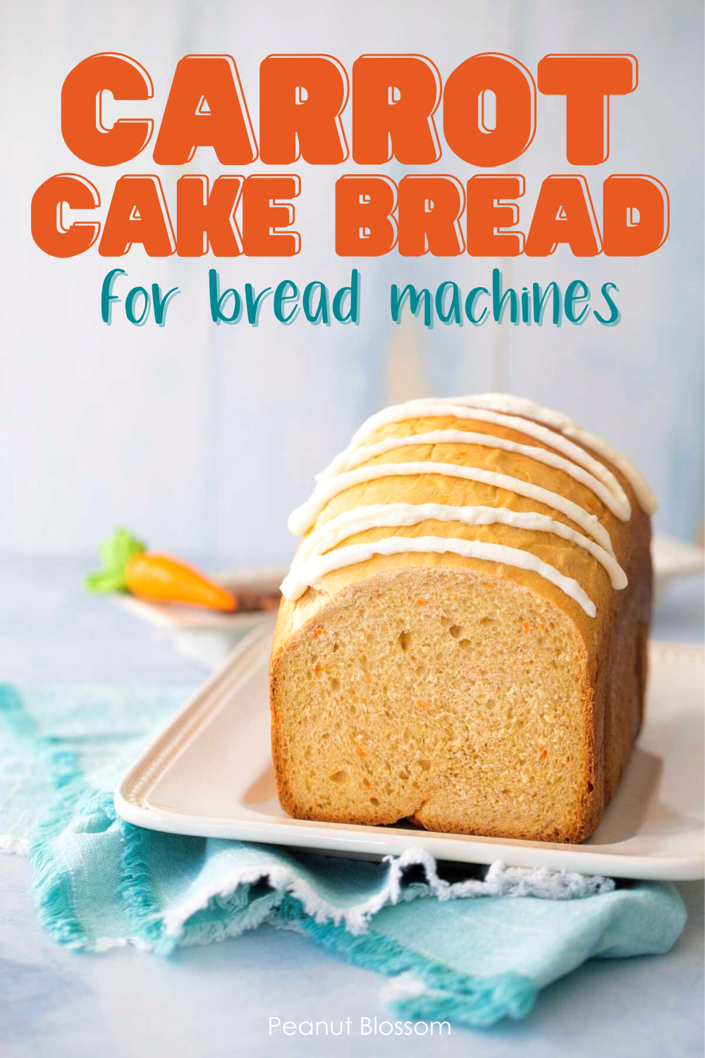 The baked carrot cake bread has been sliced so you can see the inside and is covered with a cream cheese drizzle.
