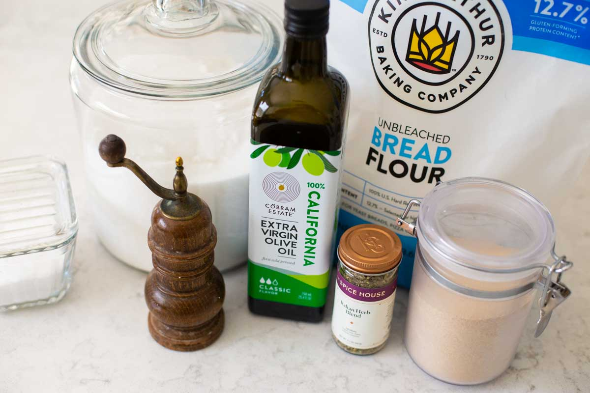 The ingredients for the bread machine focaccia are on the kitchen counter.
