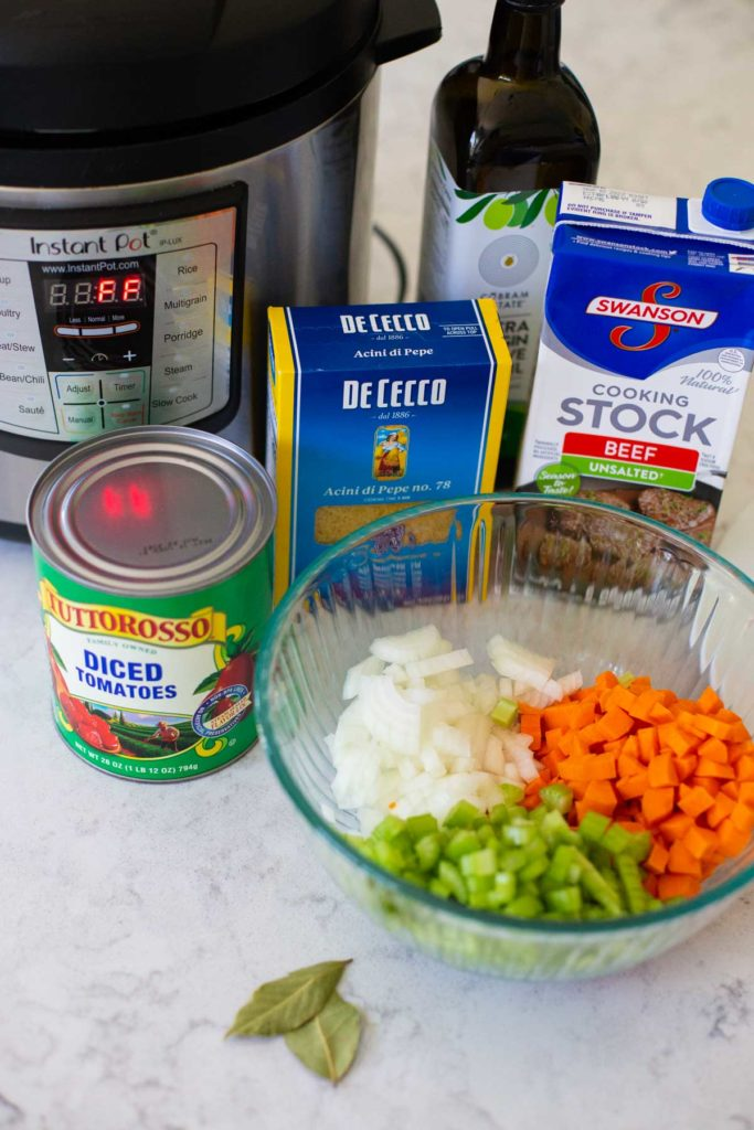 The ingredients for the ground turkey soup sit on a counter next to the Instant Pot.