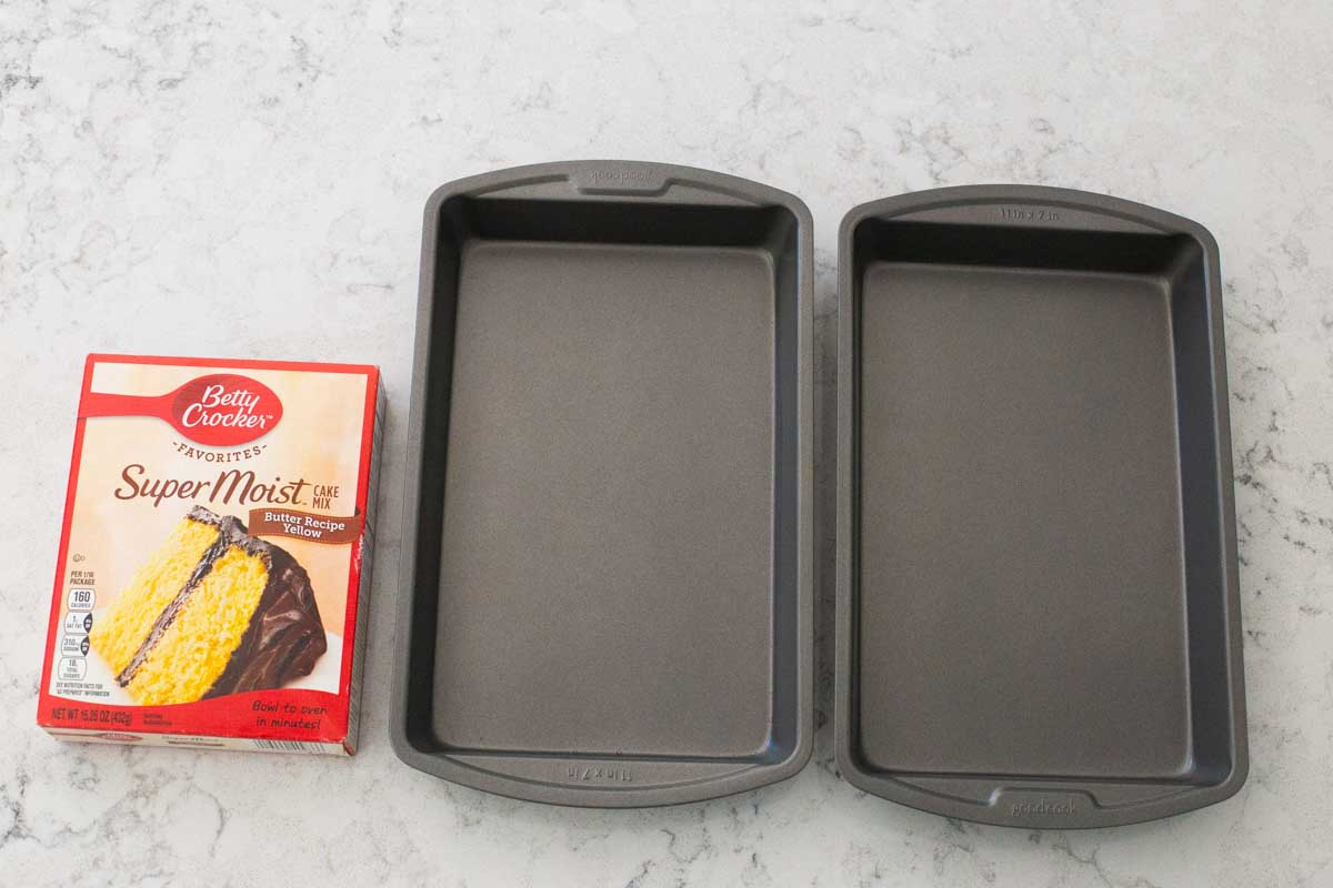 A close up of the cake pans and box cake mix used to make the monster cake.