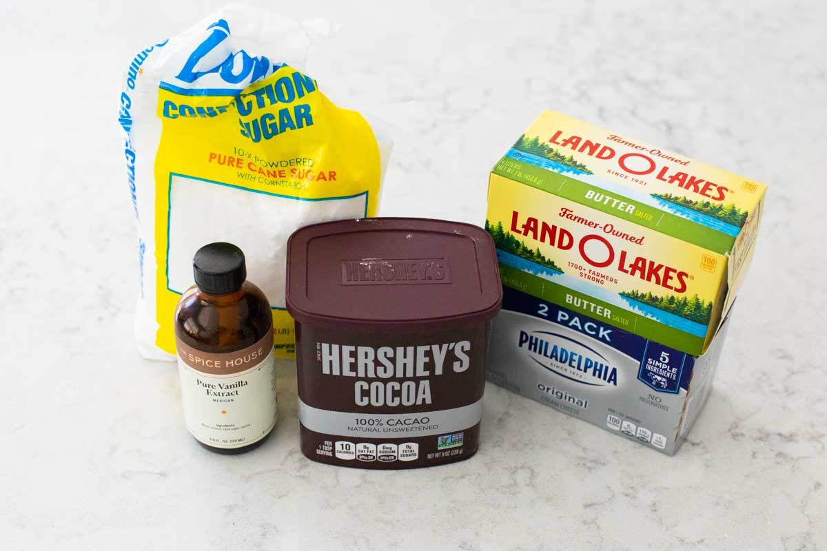 Ingredients for cream cheese frosting are on the counter.